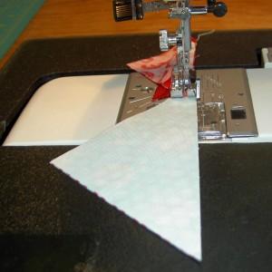 Gently put triangles under presser foot