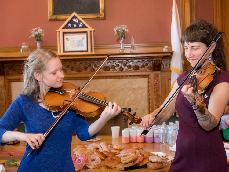 Master artist Emerald Rae Forman (right) and apprentice Elizabeth Kozachek (left) perform at the Massachusetts State House (photo by Brendan Mercure). The duo received a Traditional Arts Apprenticeship grant in 2017.