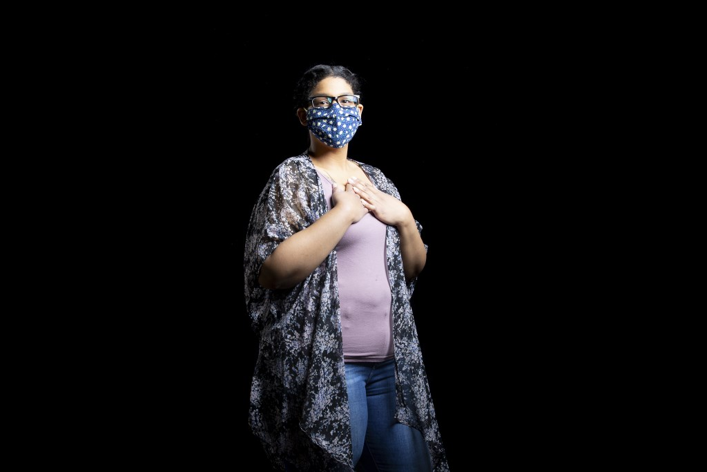 "Grisel Mendez, from the MASKS OF BOSTON project by Katherine Taylor. ""I wear N95 masks at work for 8 hours or more a day... you have to think about everyone else."""