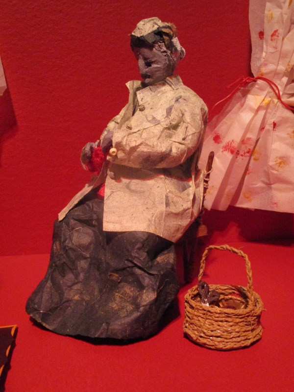 Installation view of KNITTER at NEW GILDED AGE (2020-2021) by B. Lynch, College of the Holy Cross, Worcester MA. Mixed media.