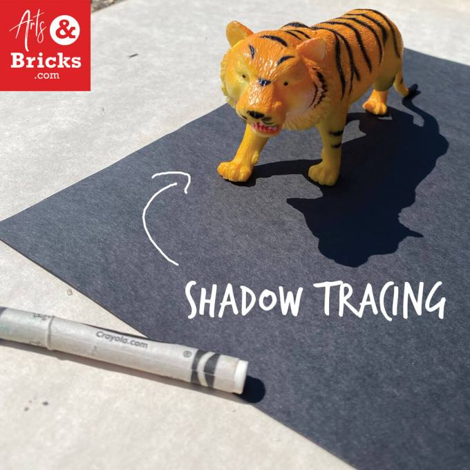 Shadow Tracing your toys with just two supplies: white crayon and black construction paper!