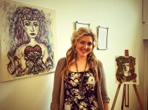 Lisa Reeve with her pieces in the pop up exhibition Photography By Lisa Reeve
