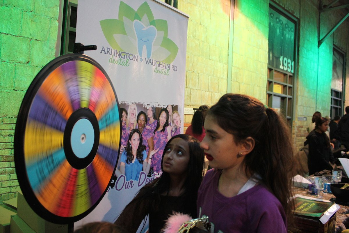 Arlington Dental Spin to Win game with kids