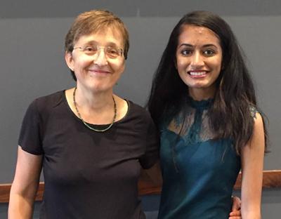 Dr. Van de Moortel next to Juhi Patel