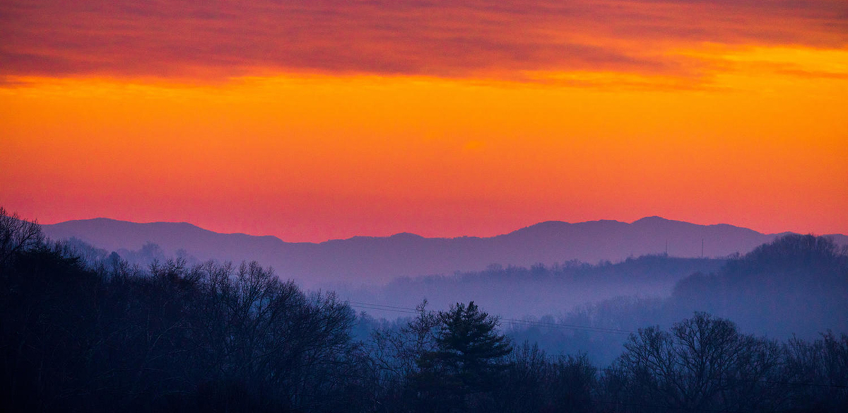 The sunrises over the Smoky Mountains from the backside of campus outside the Communications Building on February 17, 2020. Photo by Steven Bridges/University of Tennessee