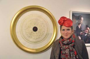 Ione Rucquoi (the only Devon artist selected for this international exhibition) in front of her worn work 'Anna & Magnus, 2015. Courtesy of Chris Lewis.