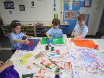 Kindergarten making painted paper