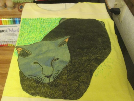 I used several shades of green fabric markers to create the grass around Irina.