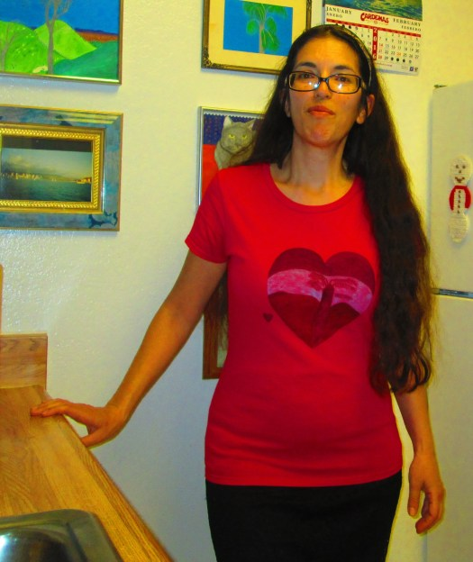 There is a silhouette of a tree with a sunset as the backdrop. This heart shirt was inspired by every day sunsets up in the San Bernardino Mountains.