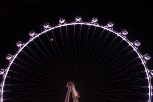Credit: Tyler Leavitt Astrophotographer Tyler Leavitt of Las Vegas caught the lunar eclipse between the spokes of the High Roller Ferris wheel on Oct. 8, 2014.