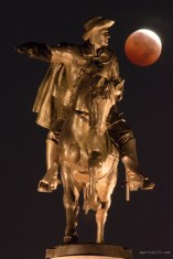 This is a shot of the October 8th 2014 eclipse from Houston, Texas. It's just one shot taken with a 500m lens feturing a statue of Sam Houston along with the partially eclipsed moon.