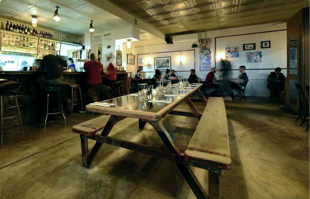 Custom interior design for Eastwick restaurant with picnic tables