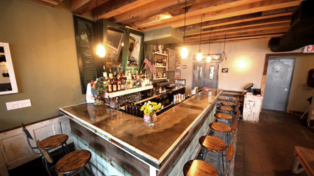 Rustic reclaimed wood and concrete bar in Brooklyn