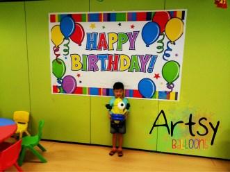 Happy birthday boy with a special balloon minion