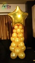 Golden balloon columns with gold foil star