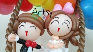wpid-balloon-wedding-couple-on-swing1.jpg.jpeg
