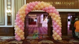Pink and beige balloon arch for weddings