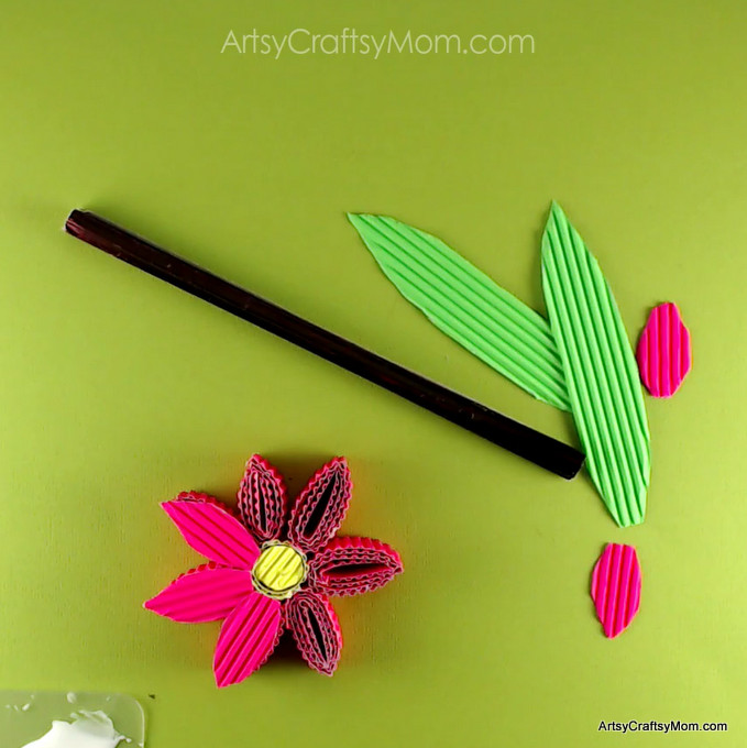 Learn how to make these 3D Corrugated Sheet Quilled Flowers. Corrugated cardboard adds a lovely texture to crafts and is easy for kids to fold. #kokorupaper