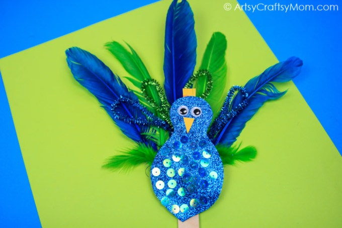 Easy Peacock craft for kids made using feathers, pipe cleaners & glitter paper. A fantastic craft to make after visiting the zoo & while learning about birds