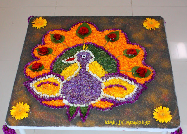 Pookolam - Spring Flower peacock rangoli Ultimate guide to Sankranti Customs, Crafts & Recipe Ideas - Makar Sankranti is the Harvest festival of the Hindus. Read about the significance of Makar Sankranti, the traditions and rituals of this festival - Bornahan, Lohri. Find out why it is celebrated? the traditional recipes - Til Gul, Pongal, Kite festival, Kite crafts to keep kids involved and informed in a fun way.