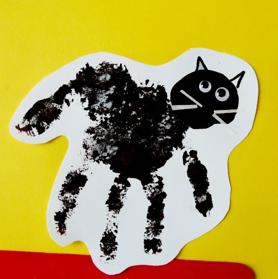 handprint black-cat - October 29th is National Cat day - Sharing our favorite 21 Cat - themed craft activities & books. Free Printable, Art and craft activities and loads of books