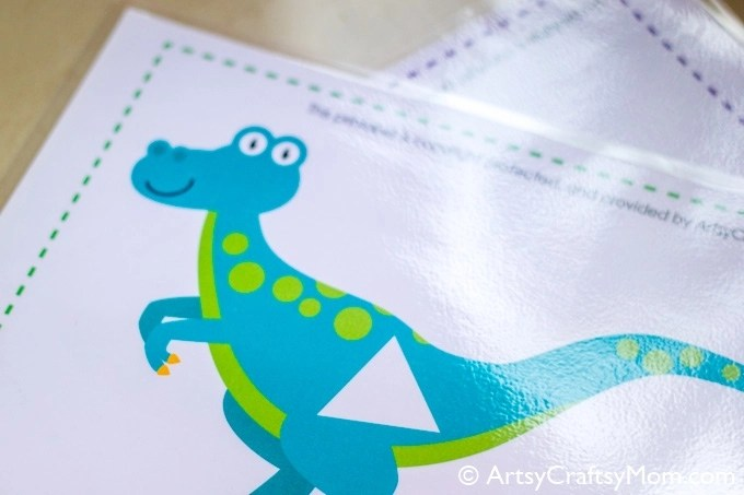 Help your little ones learn all about shapes and dinosaurs with this Montessori-inspired Printable Dinosaur Shape Match Game for kids!