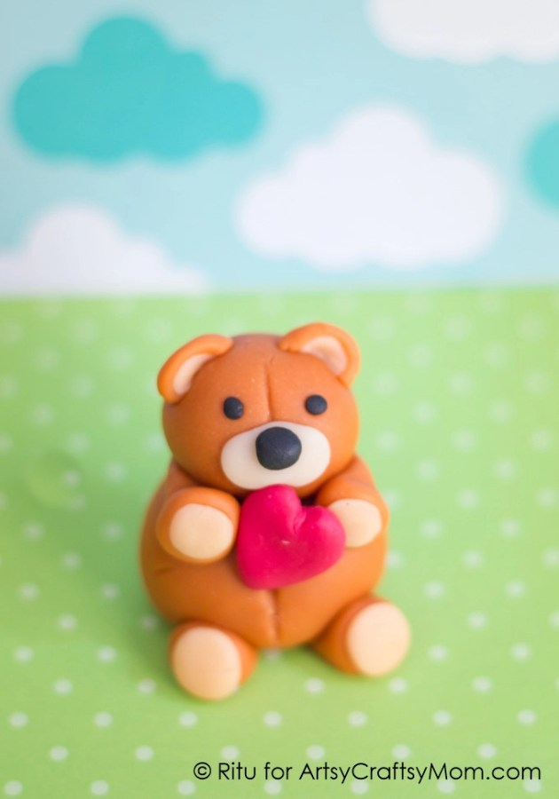 Nothing spells love like a cute little teddy bear holding a heart! Make this Valentine's Day Clay Teddy Bear for a special someone - they'll love it!