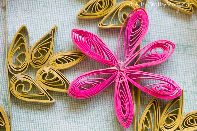 Infuse the essence of spring in your home with a Flower Garden Paper Quilling Wall Art! With flowers, butterflies & lady bugs, this sure is a pretty garden!