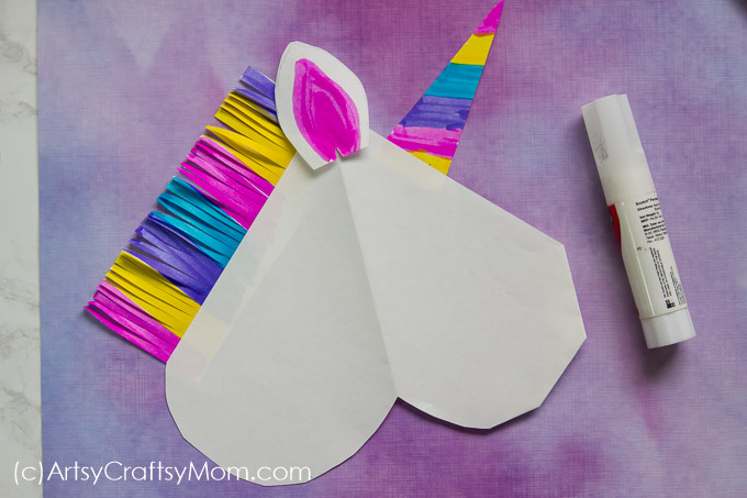 Everyone loves unicorns; especially when they're as colorful as this DIY Unicorn Valentine Paper Puppet! Delight your friends with this magical creature!