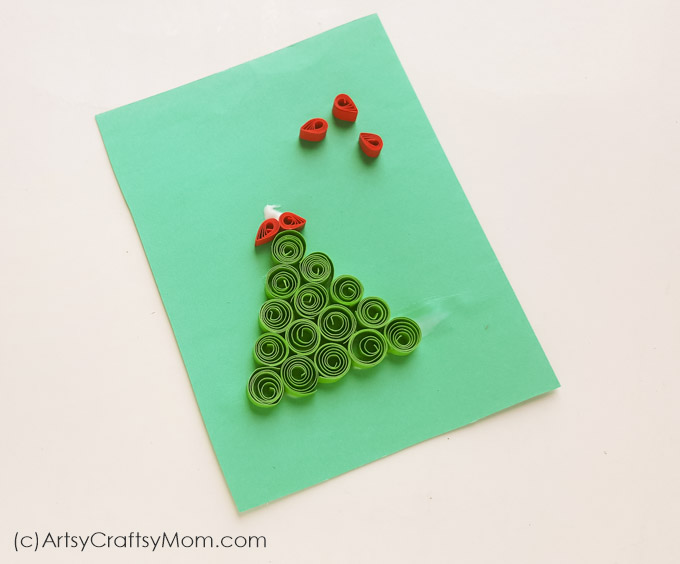 Make this cute little DIY Paper Quilling Christmas Tree Ornament to add some color & charm to your big tree! Also looks great on a handmade Christmas card!