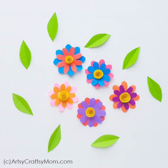 Few things describe spring as perfectly as this Spring Flowers in a Watering Can Paper Craft! This paper craft is perfect for a DIY card or as wall decor.