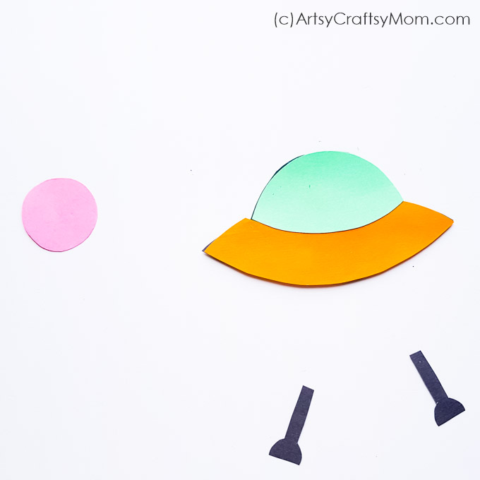 This cute paper alien spaceship craft is just what your little alien friend needs to come visit you! Easily made with craft paper and quilling strips.