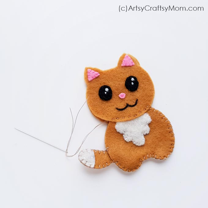 This DIY Felt Cat Plushie is the perfect gift for a cat lover in your life! With a free downloadable template, you can turn this into an ornament or charm.