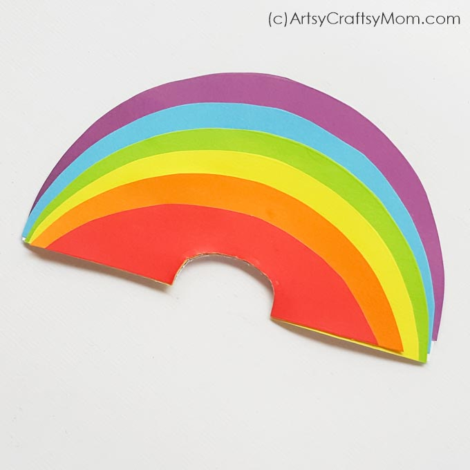 A rainbow can brighten up anyone's day, especially when it's as cheerful as this smiling rainbow paper craft! Use this to instantly perk up any space!