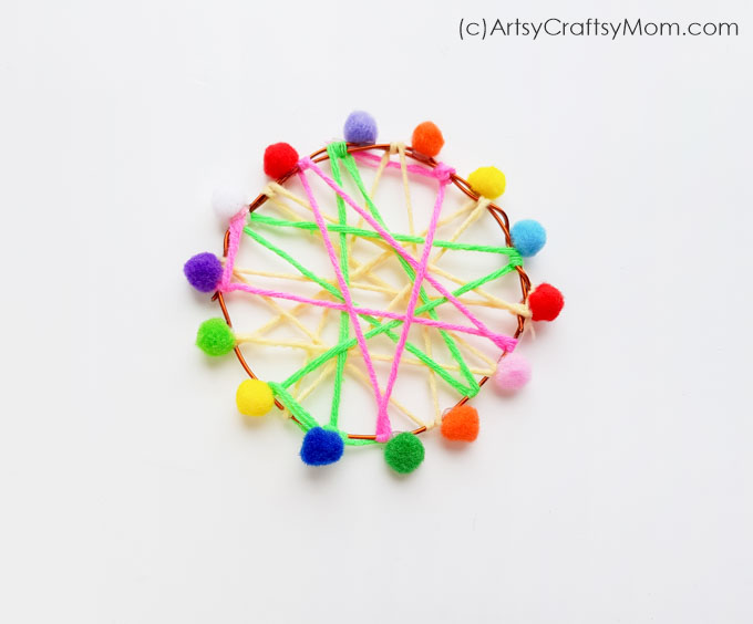 Say 'No' to nightmares with this Easy Pom Pom Dream Catcher Craft! With colored yarn and pom poms, this is an easy craft that'll brighten up your room!