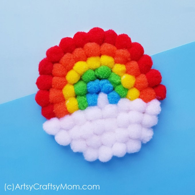 Create your very own magical rainbow with this easy pom pom rainbow craft! This is a great project for little kids to learn about colors and more!