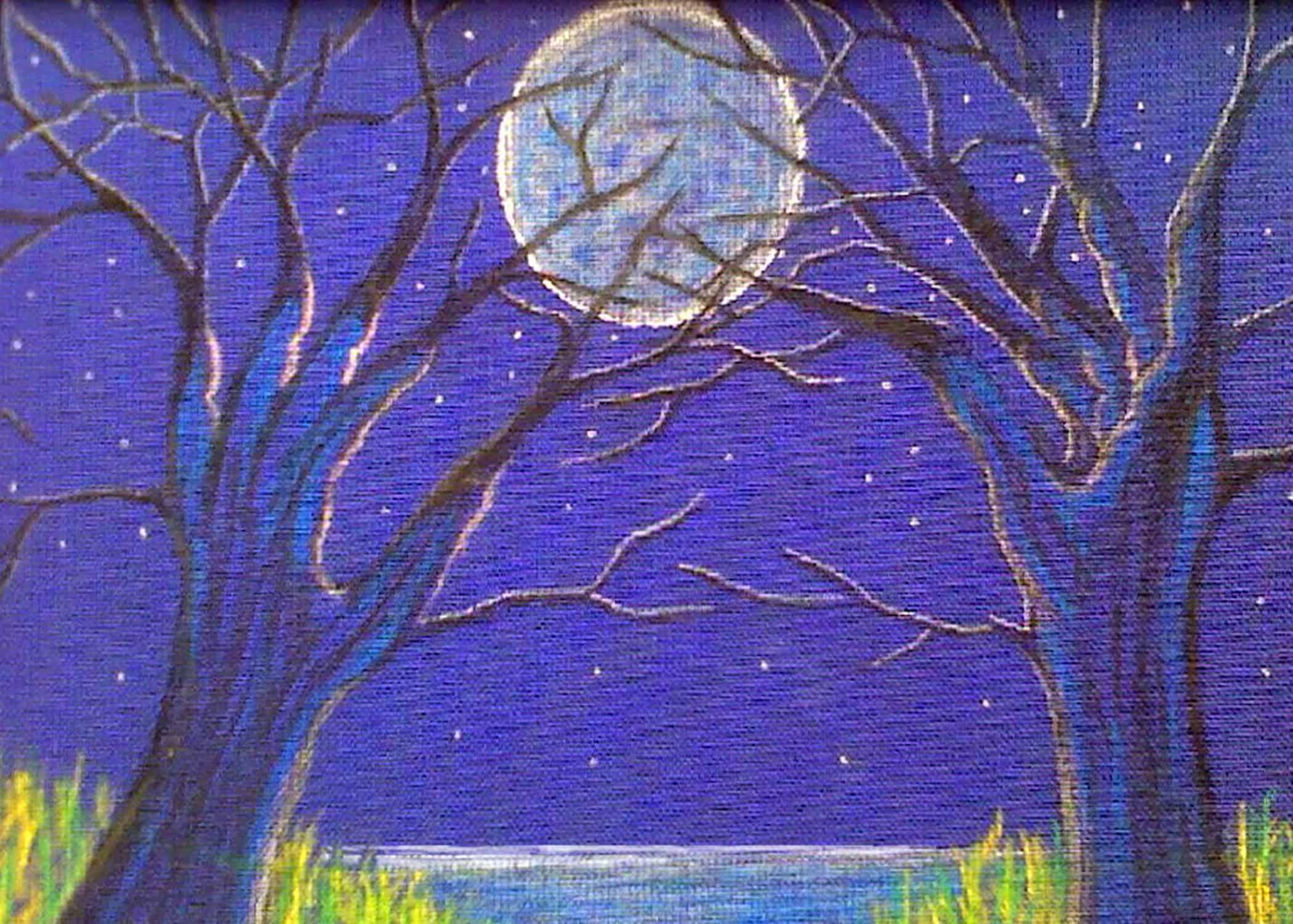 Winter tree hands reach for full moon