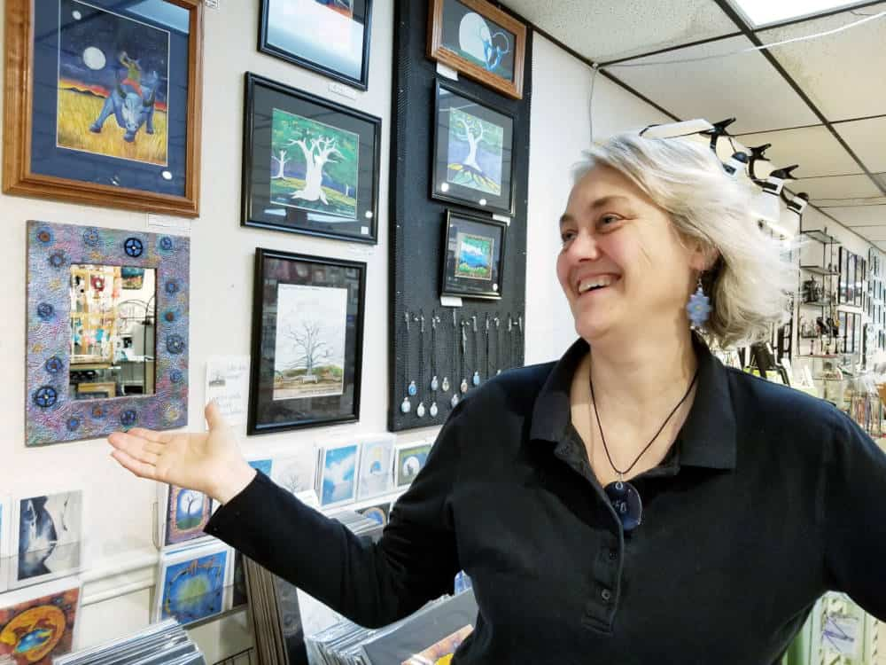 Picture of the artist in front of her display