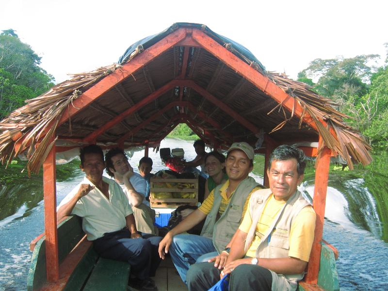 Santiago and Edwing sailing on a typical amazonian boat