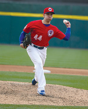 Pat Venditte pitches with his left hand.