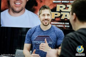 Ray Park talks with fan at a comic convention, inset, Darth Maul from Star Wars