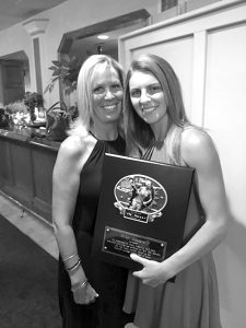 "Riley Lucarelli (r) of Lancaster High School stands with her mother Josette after receiving the girls ""Ox"" award on Monday night at the Tom Borrelli Awards dinner at DiPaolo's Restaurant. The award is presented to seniors who display the talent, versatility, hard work, dedication and toughness displayed by Borrelli in his work as a reporter and editor at the Buffalo News. Carter Stefaniak of St. Joe's was the boys winner of the ""Ox"" award."
