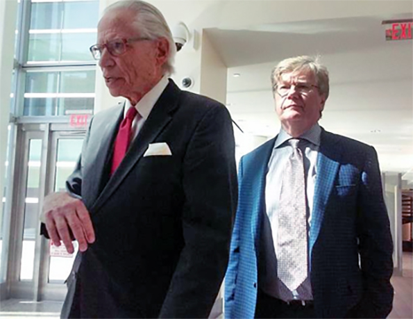Attorney Joel Daniels and Dr. Gosy leaving Federal court