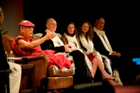 The Dalai Lama appears onstage with Clare and Sara Bronfman.