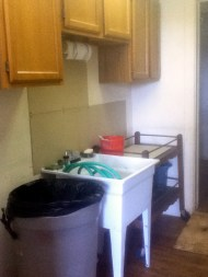 deep sink for cleaning brushes and filling buckers for projects like paper mache, large trash can (of course) and a movable cart for versatility in the space.