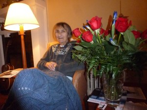 Alice sitting by the flowers sent by her friends at Performing Arts Lodge.
