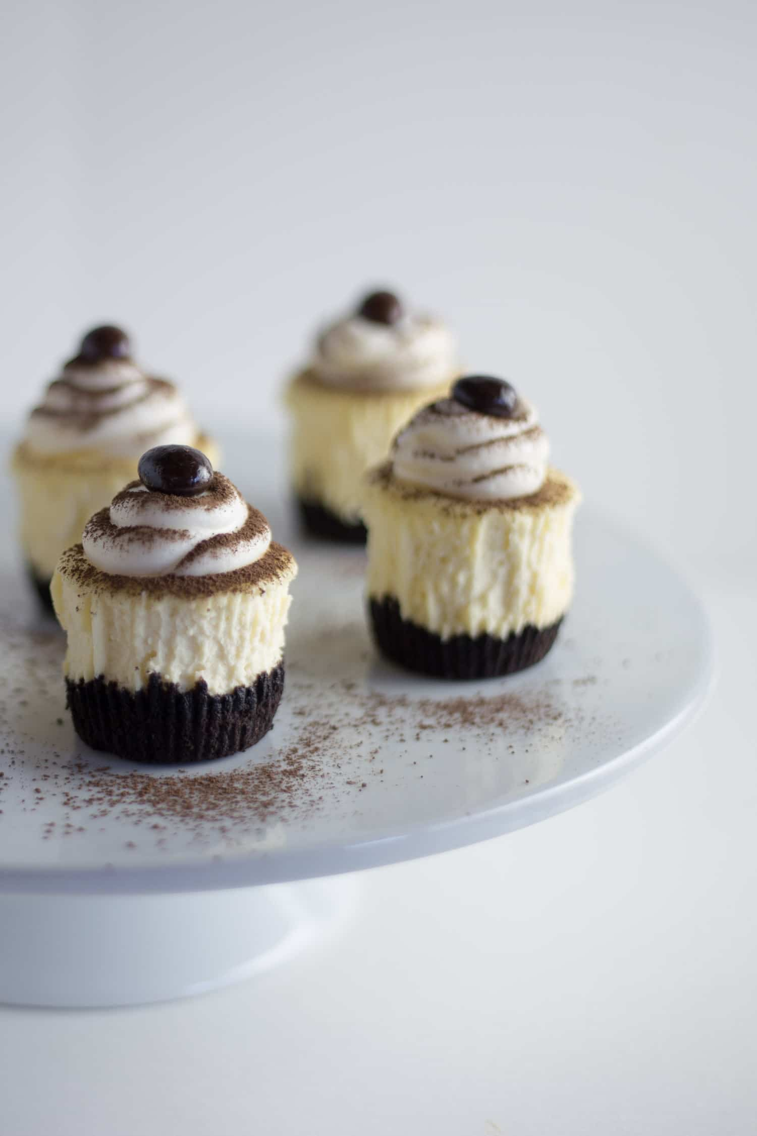 Creamy mini cheesecakes are a delicious hand held dessert that are perfect for holiday entertaining! |artzy foodie.com|