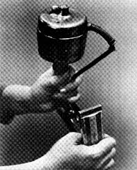 A bulky early version of Schick's electric razor