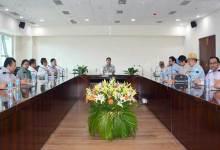 Photo of Khandu Interacts with Bureaucrats