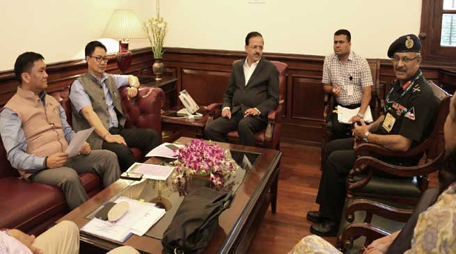 Khandu and Bhamre discuss compensation and land acquisition issues for defence purposes